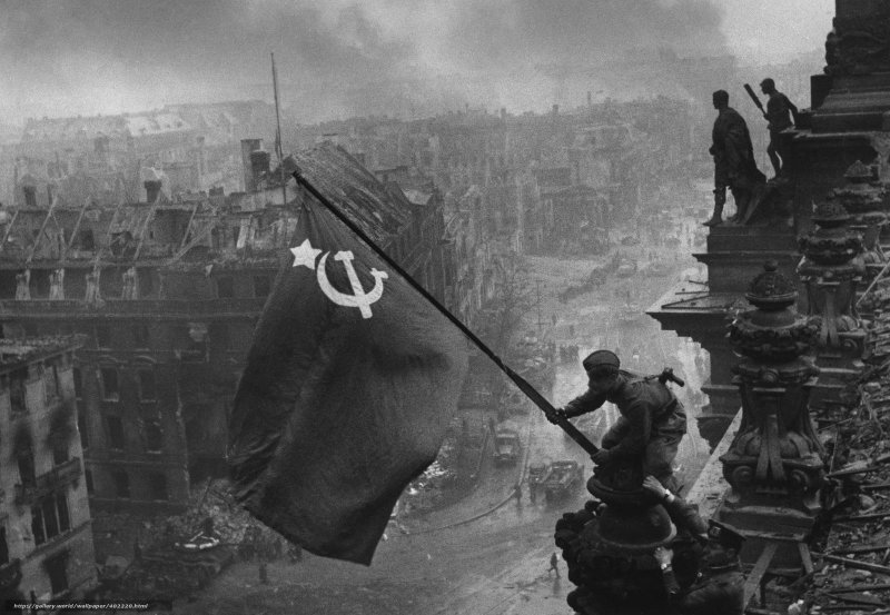Raising a Flag over the Reichstag, by Yevgeny Khaldei
